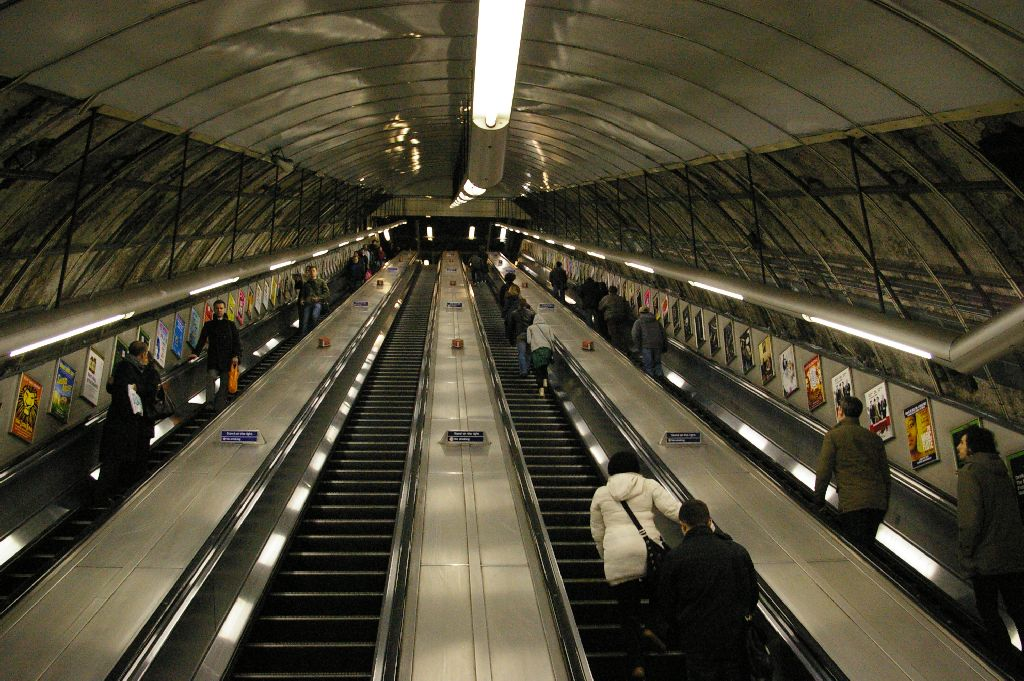 "https://commons.wikimedia.org/wiki/File:Holborn_Tube_Station_Escalator.jpg - Creative Commons - ""Holborn Tube Station Escalator"" by renaissancechambara"