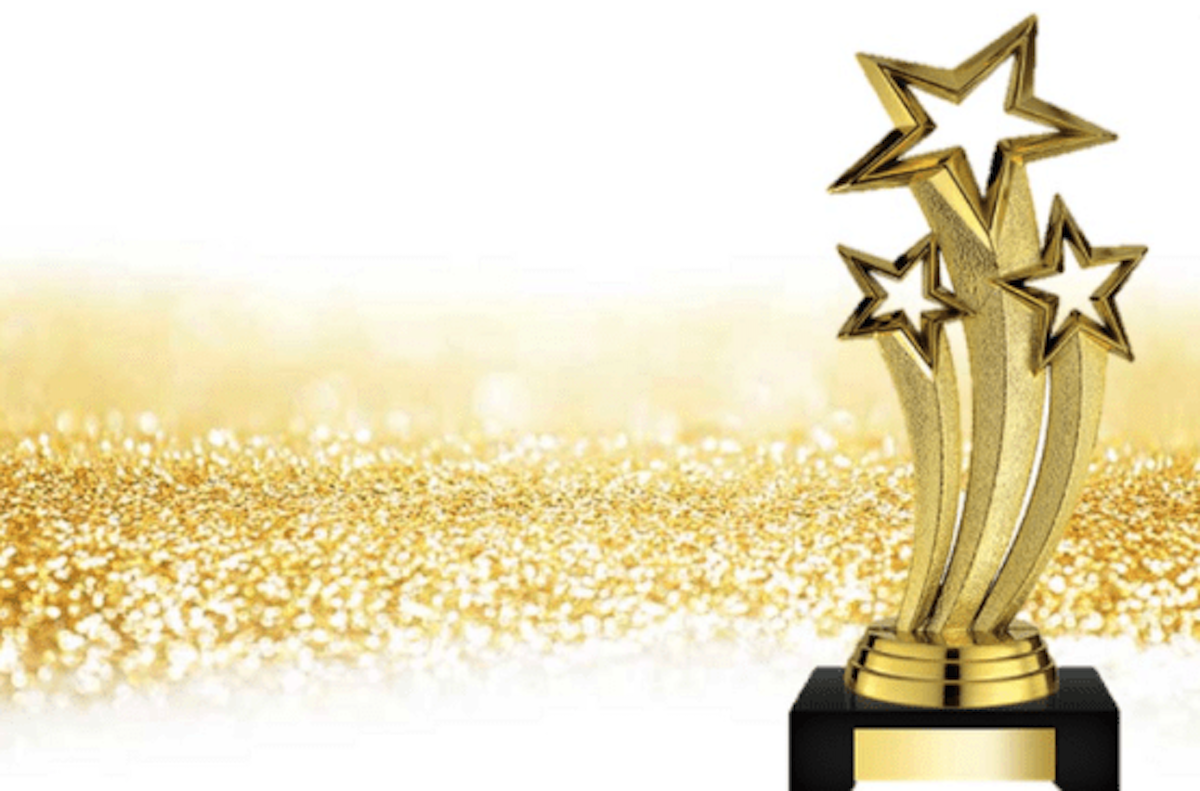 A golden awards statue with three stars at the top.